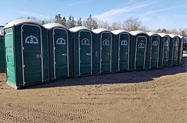 row of gotta go potties portable toilets